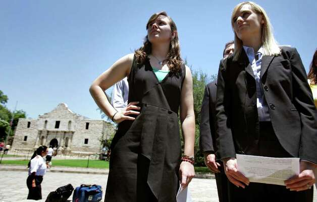 Medina Valley High School valedictorian Angela Hildenbrand (left) with Erin Leu, an attorney from the Liberty Institute, in front of the Alamo. Photo: Bob Owen/Express-News / rowen@express-news.net