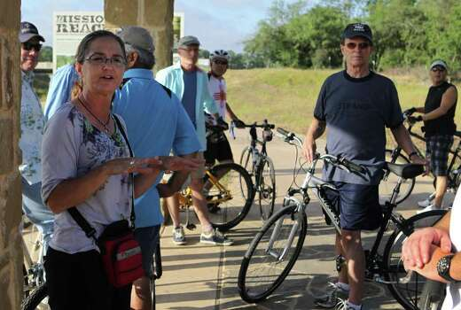 "Lee Marlowe, Natural Resource Management Specialist for the San Antonio River Authority  (left, gesturing), speaks about plants and wildlife along the Mission Reach area of the San Antonio River. Marlowe was speaking to a group of cyclists including Bexar County Judge Nelson Wolff (right, dark cap) and Bexar County Commissioner Sergio ""Chico"" Rodriguez (background right, wearing white visor) who were touring the area on Thursday, June 2, 2011. Photo: John Davenport/Express-News"