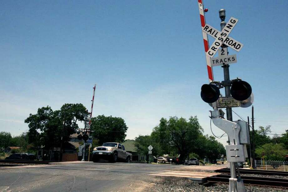 A pickup crosses the railroad tracks on South San Jacinto Street near Saltillo Street. The City Council voted Thursday to close the railroad crossing to pave the way for the creation of a railroad quiet zone. Photo: Omar Perez/Express-News / SAN ANTONIO EXPRESS-NEWS