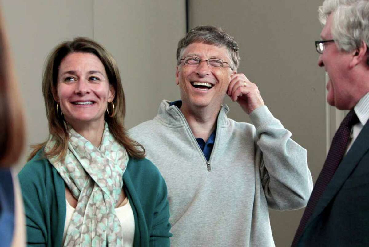 Melinda Gates, left, and husband Bill Gates laugh with Jeff Raikes following speaking at the opening reception of the Bill & Melinda Gates Foundation Thursday, June 2, 2011, in Seattle. The foundation formally opened the new headquarters Thursday evening, moving from scattered nondescript office buildings around Seattle to an architectural showcase in the center of its hometown.