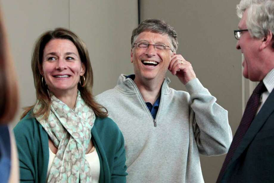 Melinda Gates, left, and husband Bill Gates laugh with Jeff Raikes following speaking at the opening reception of the Bill & Melinda Gates Foundation Thursday, June 2, 2011, in Seattle. The foundation formally opened the new headquarters Thursday evening, moving from scattered nondescript office buildings around Seattle to an architectural showcase in the center of its hometown. Photo: AP