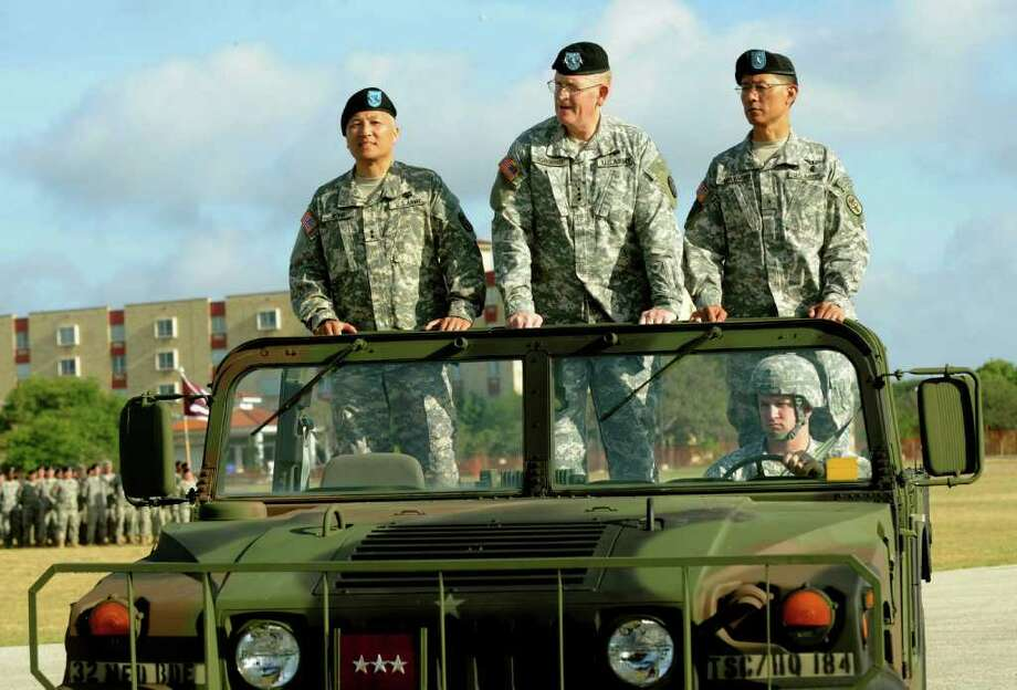 Maj. Gen. M. Ted Wong (left), incoming commander of Brooke Army Medical Center and the Southern Regional Medical Command, accompanies Lt. Gen. Eric Schoomaker (middle) and Brig. Gen. Joseph Caravalho Jr. as they review troops. Photo: Billy Calzada/Express-News / gcalzada@express-news.net