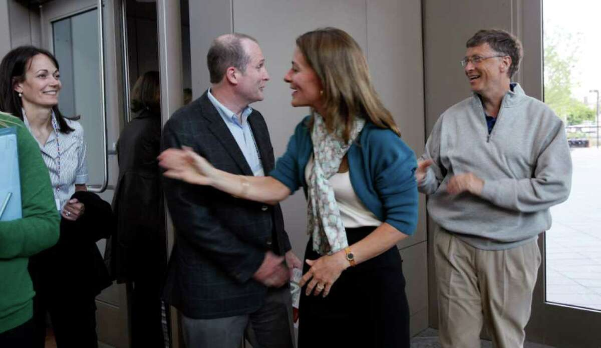Bill Gates, right, and Melinda Gates greet guests at the opening reception of the Bill & Melinda Gates Foundation Thursday, June 2, 2011, in Seattle. The foundation formally opened the new headquarters Thursday evening, moving from scattered nondescript office buildings around Seattle to an architectural showcase in the center of its hometown.