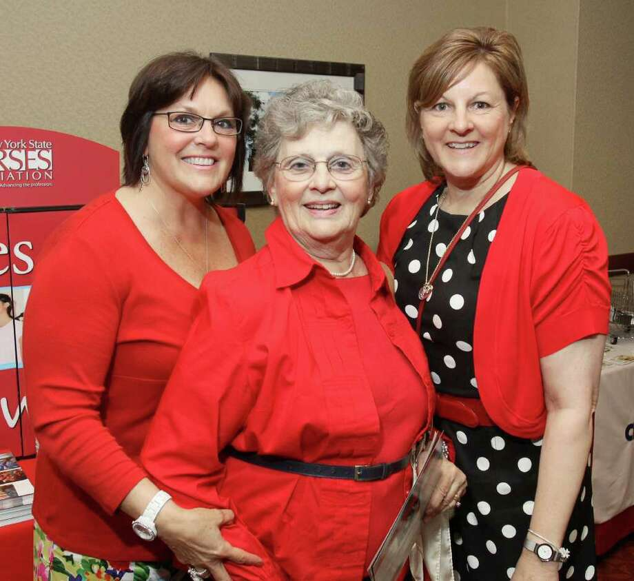 Elizabeth Haight (center) poses with her daughters Sue Dibble (left) and NYS Nurses Association Deputy Executive Officer Deborah Elliott (right) during the 7th Annual Go Red For Women Luncheon in Troy to benefit the American Heart Association. (Photo by Joe Putrock/Special to the Times Union) Photo: Joe Putrock / Joe Putrock