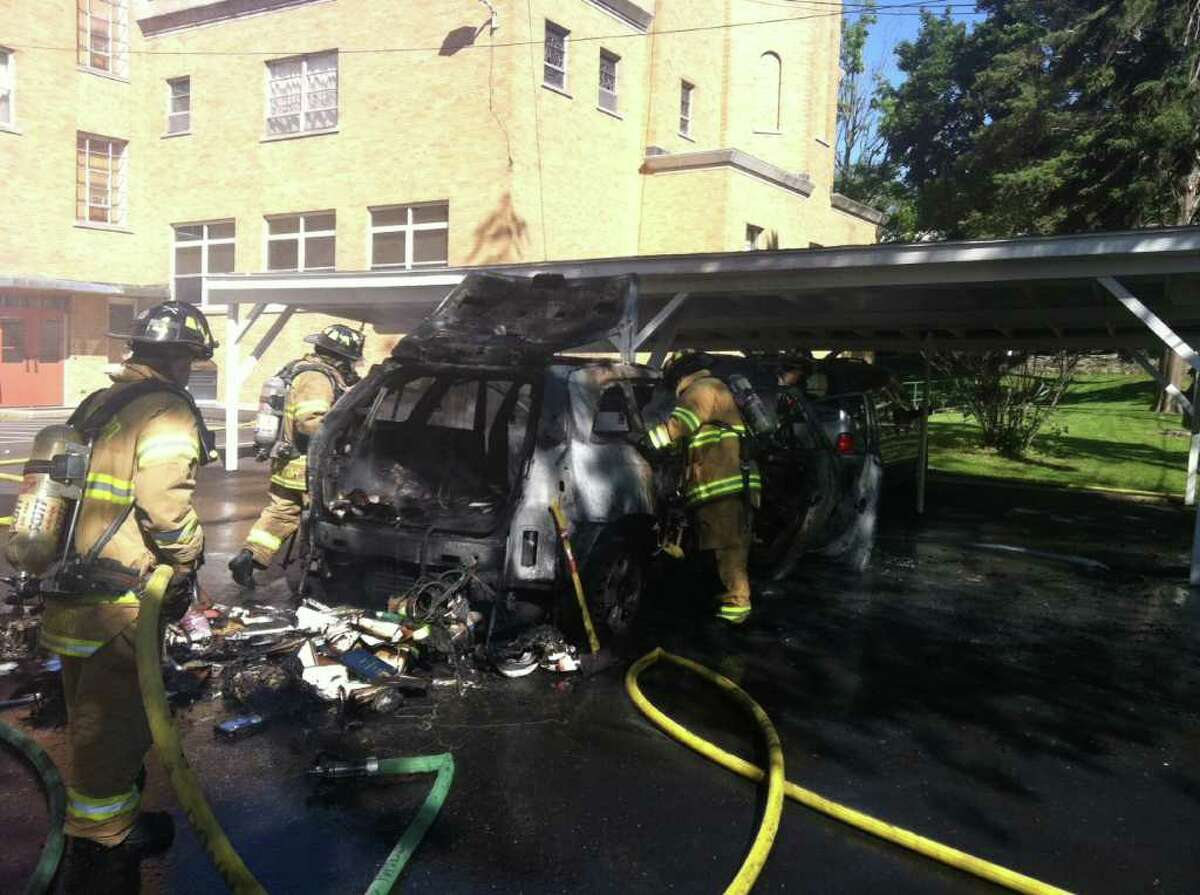 A 2004 chrysler Pacifica caught fire in the parking lot of St. Basil's Ukrainian Church on Glenbrook Road in Stamford on Friday, June 3, 2011. The car belonging to Father Robert Markovitch caught fire moments after it was parked in the church parking lot.