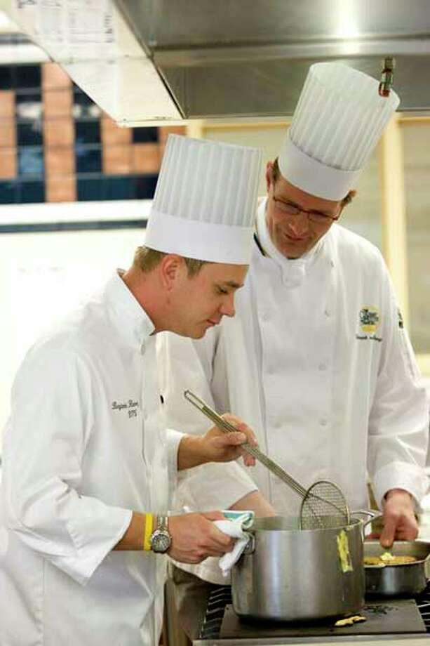 Chef-Instructor Chef Hinnerk Von Bargen mentors a student enrolled in the Culinary Arts Certificates program. Courtesy photo