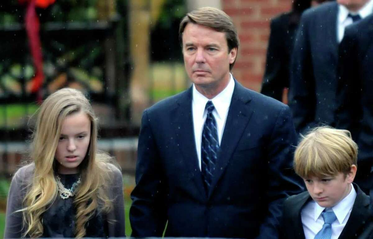 RALEIGH, NC - DECEMBER 11: Former North Carolina senator and Democratic presidential candidate John Edwards and his children Emma Claire (L) and Jack leave the funeral services for Elizabeth Edwards at Edenton Street United Methodist Church on December 11, 2010 in Raleigh, North Carolina. Edwards died Tuesday after a six year battle with breast cancer at the age of 61. (Photo by Sara D. Davis/Getty Images) *** Local Caption *** Jack Edwards; Emma Claire Edwards;John Edwards