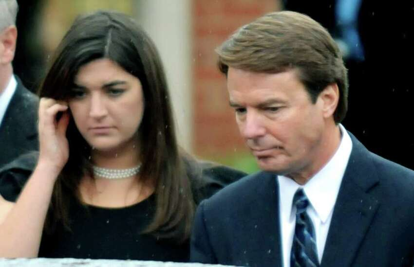 RALEIGH, NC - DECEMBER 11: Former North Carolina senator and Democratic presidential candidate John Edwards and his daughter Cate leave the funeral services for Elizabeth Edwards at Edenton Street United Methodist Church on December 11, 2010 in Raleigh, North Carolina. Edwards died Tuesday after a six year battle with breast cancer at the age of 61. (Photo by Sara D. Davis/Getty Images) *** Local Caption *** Cate Edwards;John Edwards