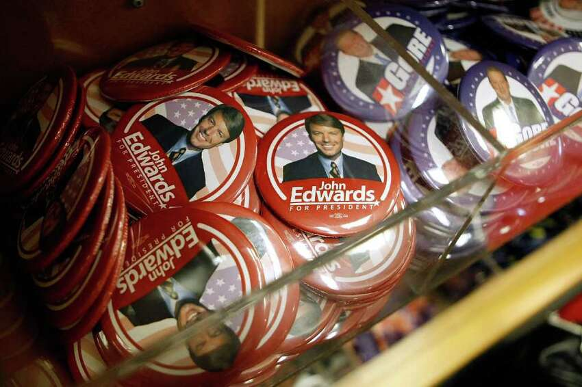 WASHINGTON - DECEMBER 12: Buttons with the image of former Democratic presidential candidate John Edwards are just some of the merchandise available at Political Americana's inaugural store near the White House December 12, 2008 in Washington, DC. Opening in time for the holidays, the store carries thousands of items including life-size photographic cutouts of President-elect Barack Obama and Vice President-elect Joe Biden, along with posters, hats, t-shrits and golf balls. (Photo by Chip Somodevilla/Getty Images)