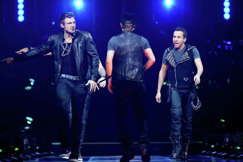 UNCASVILLE, CT - JUNE 02: Nick Carter (L), Brian Littrell (C), and Howie Dorough of the Backstreet Boys perform at Mohegan Sun Arena on June 2, 2011 in Uncasville, Connecticut. (Photo by David Surowiecki/Getty Images)