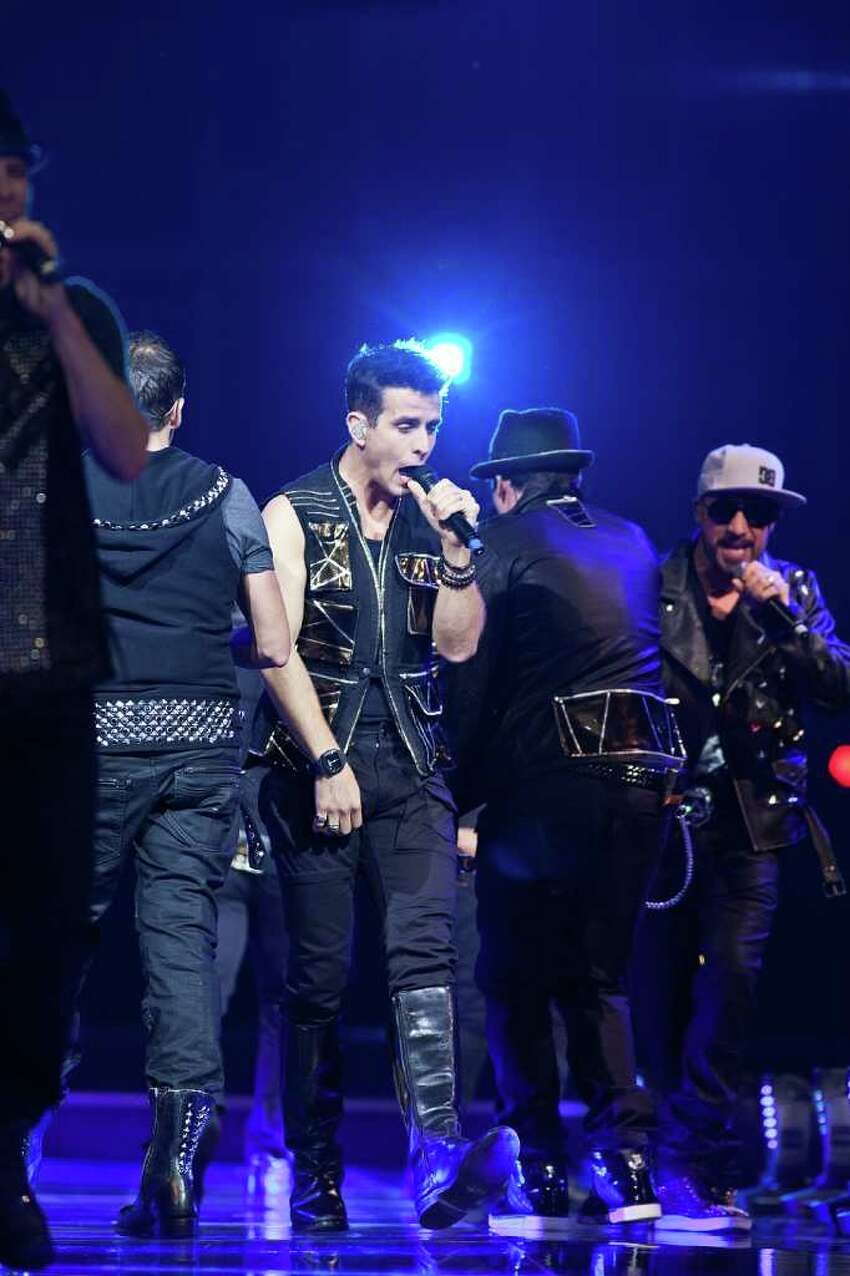UNCASVILLE, CT - JUNE 02: Joey McIntyre (C) and A.J. McLean (R) sing as New Kids On The Block and Backstreet Boys perform together at Mohegan Sun Arena on June 2, 2011 in Uncasville, Connecticut. (Photo by David Surowiecki/Getty Images)