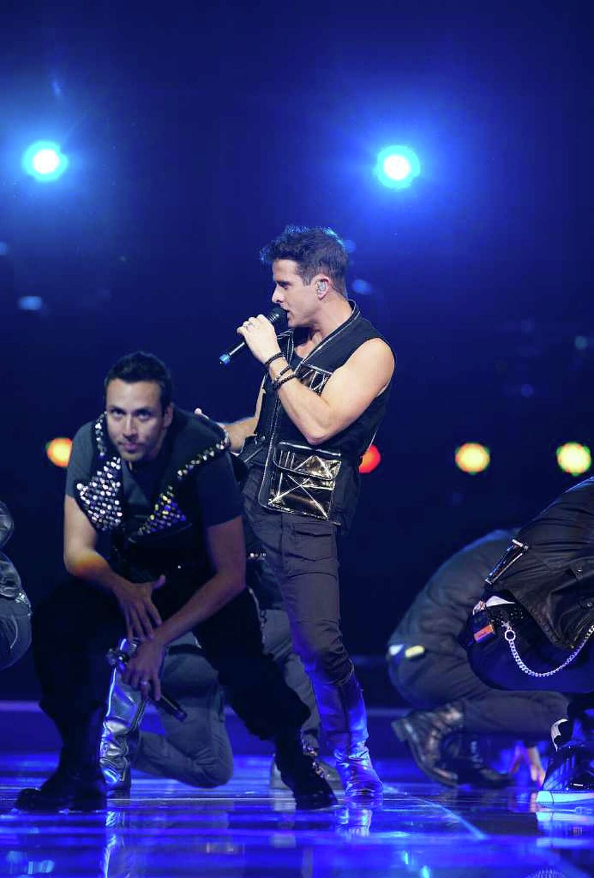 UNCASVILLE, CT - JUNE 02: Howie Dorough (L) and Joey McIntyre perform at the New Kids On The Block and Backstreet Boys concert at Mohegan Sun Arena on June 2, 2011 in Uncasville, Connecticut. (Photo by David Surowiecki/Getty Images)