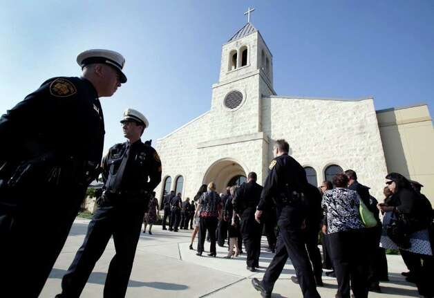 Law officers arrive for funeral services for Sgt. Kenneth Gary Vann of the Bexar County Sheriff Office, at St. Joseph of Honey Creek Catholic Church in Spring Branch, June 3, 2011. Photo: Bob Owen, Bob Owen/rowen@express-news.net / rowen@express-news.net