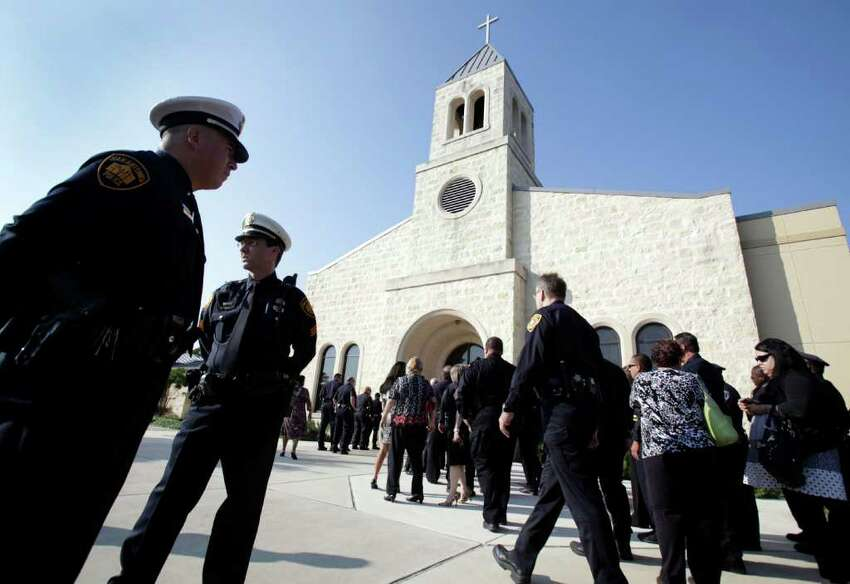 Law officers arrive for funeral services for Sgt. Kenneth Gary Vann of the Bexar County Sheriff Office, at St. Joseph of Honey Creek Catholic Church in Spring Branch, June 3, 2011.