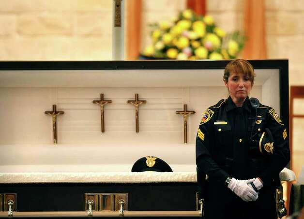 Standing in front of her husband's casket, Bexar County Sheriff Deputy Sgt Yvonne Vann waits to greet fellow officers and friends before funeral services for Sgt. Kenneth Gary Vann of the Bexar County Sheriff Office, at St. Joseph of Honey Creek Catholic Church in Spring Branch, June 3, 2011. Photo: Lisa Krantz, Lisa Krantz/lkrantz@express-news.net / lkrantz@express-news.net
