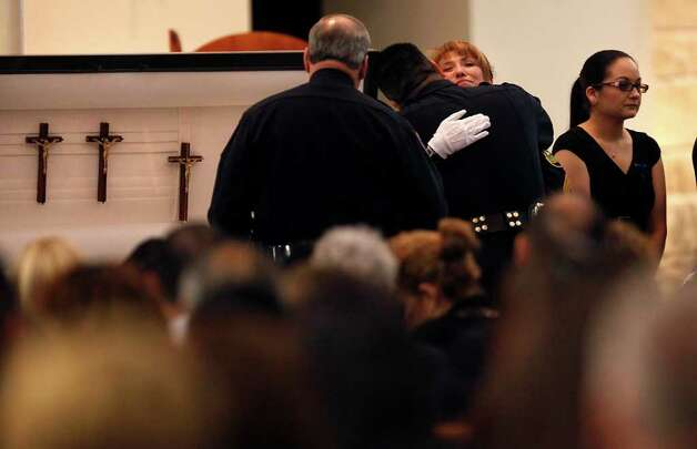 Standing in front of her husband's casket, Bexar County Sheriff Deputy Sgt. Yvonne Vann greets law officers from around the state before funeral services for Sgt. Kenneth Gary Vann of the Bexar County Sheriff Office, at St. Joseph of Honey Creek Catholic Church in Spring Branch, June 3, 2011. Vann's daughter Rachael Vann is at right. Photo: Lisa Krantz, Lisa Krantz/lkrantz@express-news.net / lkrantz@express-news.net