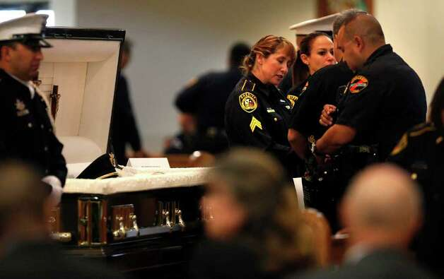 Standing in front of her husband's casket, Bexar County Sheriff Deputy Sgt. Yvonne Vann greets law officers from around the state before funeral services for Sgt. Kenneth Gary Vann of the Bexar County Sheriff Office, at St. Joseph of Honey Creek Catholic Church in Spring Branch, June 3, 2011. Photo: Lisa Krantz, Lisa Krantz/Express-News / lkrantz@express-news.net