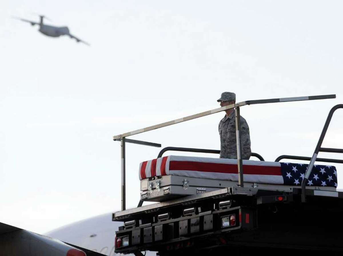 A transfer case containing the remains of Army Spc. Richard C. Emmons III sits on a loader Thursday, June 2, 2011 at Dover Air Force Base, Del. According to the Department of Defense, Emmons, 22, of North Granby, Conn., died May 31, 2011 in Logar province, Afghanistan of wounds sustained when enemy forces attacked his unit with a rocket propelled grenade. (AP Photo/Steve Ruark)