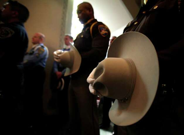Members of the Honor Guard of the Fort Bend County Sheriff's Office pray in the overflow chapel during funeral services for Sgt. Kenneth Gary Vann of the Bexar County Sheriff Office, at St. Joseph of Honey Creek Catholic Church in Spring Branch, June 3, 2011. Photo: Bob Owen, Bob Owen/rowen@express-news.net / rowen@express-news.net