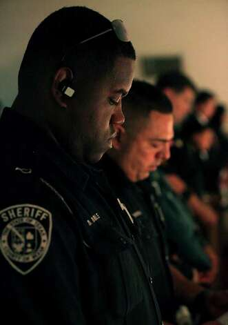 Bexar County Sheriff Deputy Brent Bible prays in the overflow chapel during funeral ervices for Sgt. Kenneth Gary Vann of the Bexar County Sheriff Office, at St. Joseph of Honey Creek Catholic Church in Spring Branch, June 3, 2011. Photo: Bob Owen, Bob Owen/rowen@express-news.net / rowen@express-news.net