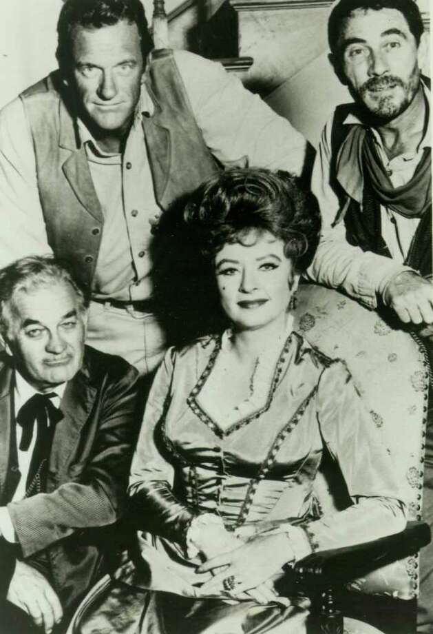 "TODAY IN HISTORY/SUN 09 10 00/GUNSMOKE - James Arness, Amanda Blake, Milburn Stone, and Ken Curtis star in television's longest running western, ""Gunsmoke.""  The show premiered on CBS on September 10, 1955.  (PHOTO UNDATED)  CREDIT: EXPRESS-NEWS FILE PHOTO (SOURCE: E-N FILE PHOTO) Photo: EXPRESS-NEWS FILE PHOTO / EXPRESS-NEWS FILE PHOTO"