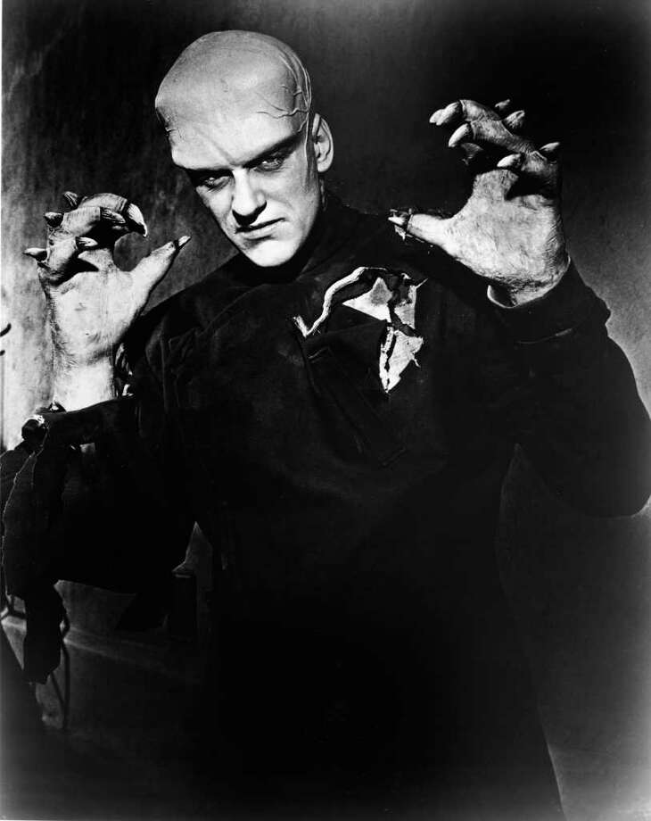 American actor James Arness holds up his claw-like hands in a publicity still from the horror film 'The Thing (From Another World),' 1951. In the movie, Arness plays a pilot, discovered frozen in a spacecraft in the artic by researchers, who thaws out and is revealed to be not of this earth. (Photo by Hulton Archive) Photo: Hulton Archive, Getty Images / 2005 Getty Images