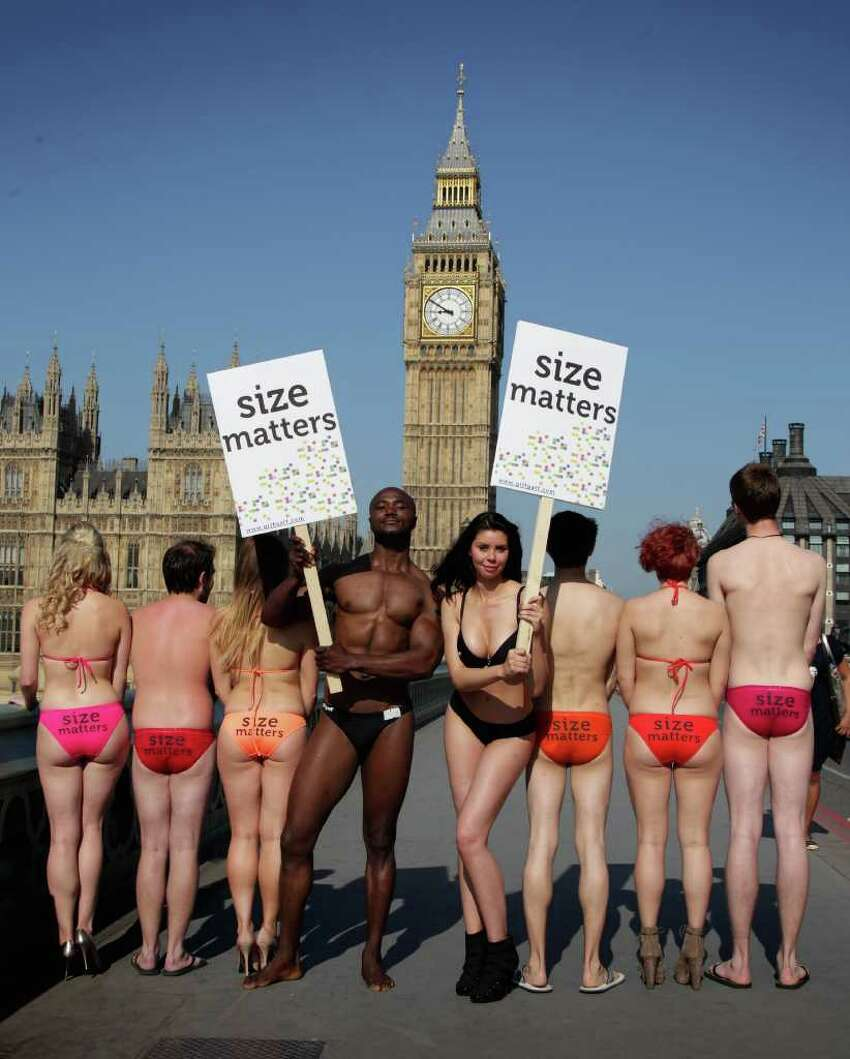 Models pose in front of Big Ben as part of the 'Size Matters' campaign by community-led mobile operator giffgaff on in London, United Kingdom.