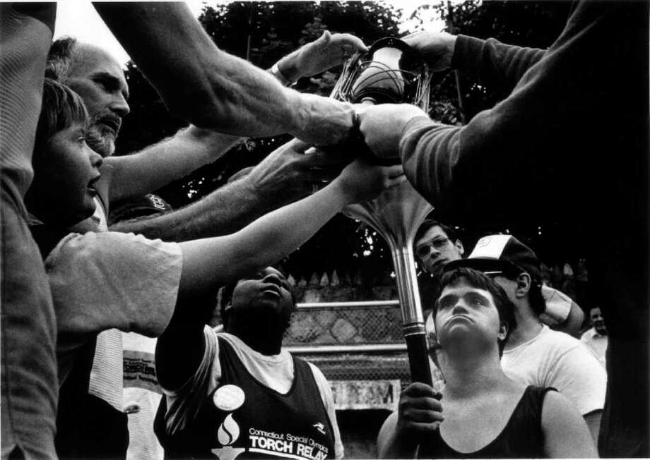 June 9, 1986: Eric Hagander holds the Special Olympics Summer Game torch before running with it for a mile through Stamford. Photo: File Photo / Stamford Advocate File Photo