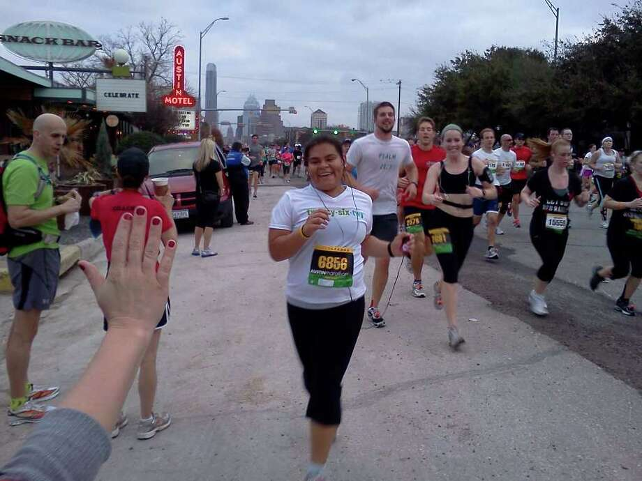 "Ashley Castoreno, subject of the childhood obesity documentary ""Health Neewds a Hero,""  completes the Livestrong Austin Marathon in February, 2011."