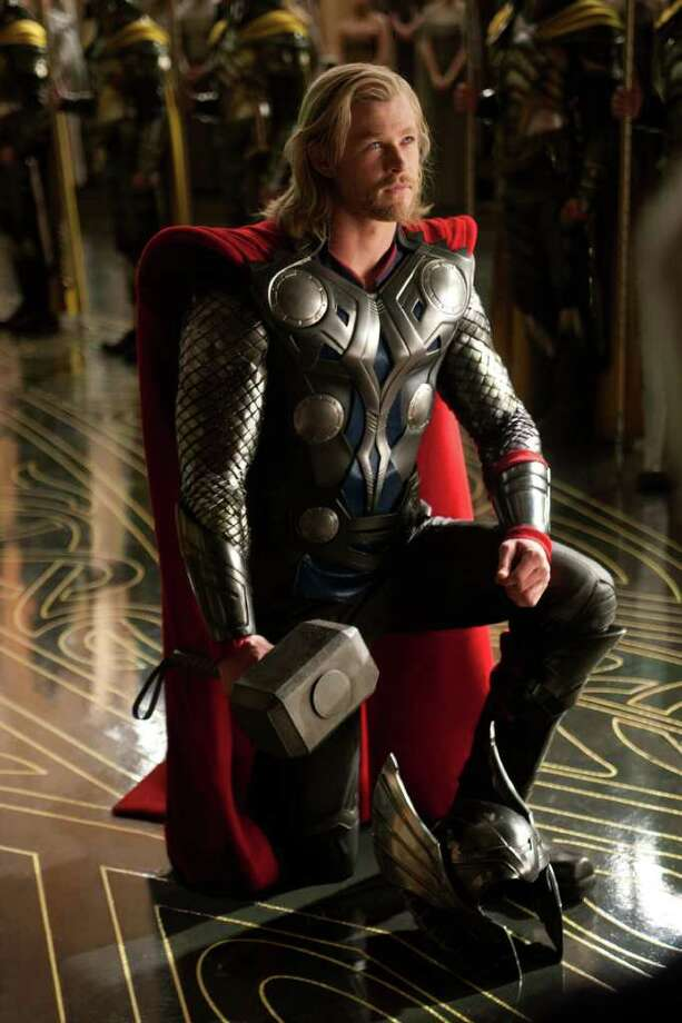 """In this film publicity image released by Paramount Pictures, Chris Hemsworth portrays the title character in a scene from the film, """"Thor."""" (AP Photo/Paramount Pictures-Marvel Studios, Zade Rosenthal) Photo: Zade Rosenthal, HOEP / Paramount Pictures"""