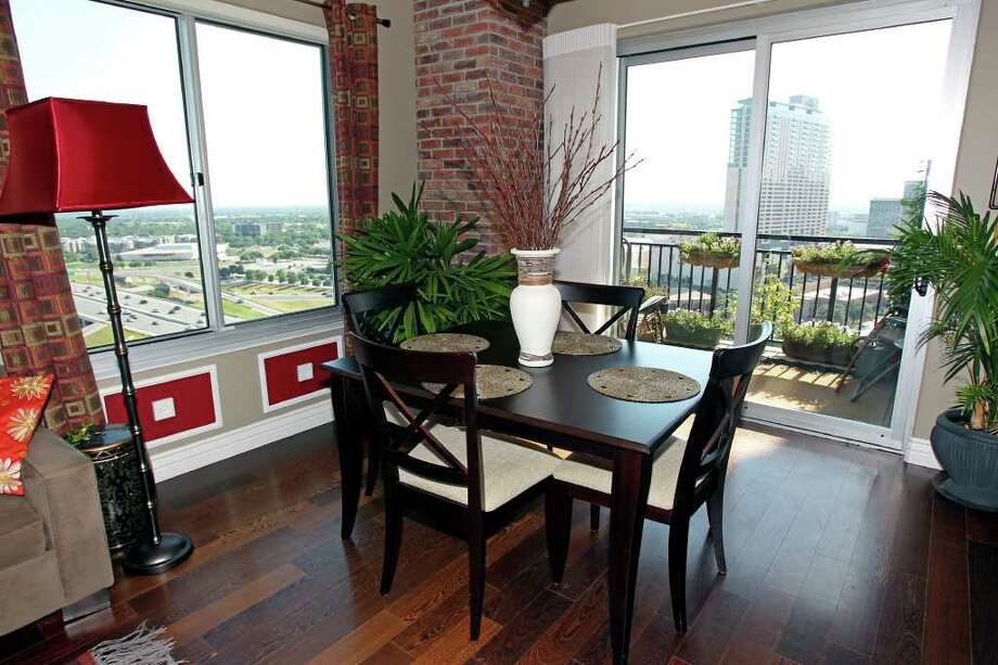 Jim and Donna Perkins had the dining table from their previous home cut down to fit the condo's dining area, which offers panoramic views of HemisFair Park and downtown. Photo: TOM REEL, SAN ANTONIO EXPRESS-NEWS / © 2011 San Antonio Express-News