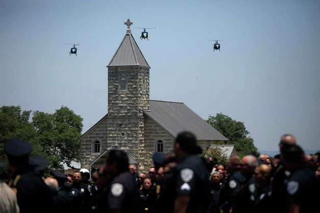 Helicopters fly over the funeral for Bexar County Sheriff Deputy Sgt. Kenneth Gary Vann at St. Joseph Catholic Cemetery at Honey Creek in Spring Branch on Friday, June 3, 2011. LISA KRANTZ/lkrantz@express-news.net Photo: LISA KRANTZ, Express-News / SAN ANTONIO EXPRESS-NEWS
