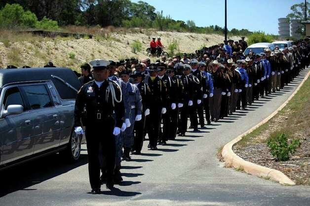 Law Enforcement Honor Guards from across Texas escort the procession from the church to the cemetery during the funeral for Bexar County Sheriff Deputy Sgt. Kenneth Gary Vann at St. Joseph Catholic Church at Honey Creek in Spring Branch on Friday, June 3, 2011. LISA KRANTZ/lkrantz@express-news.net Photo: LISA KRANTZ, Express-News / SAN ANTONIO EXPRESS-NEWS