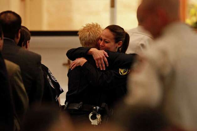 Bexar County Sheriff Deputy Anita Price, right, embraces a fellow deputy as mourners pay their respects to Bexar County Sheriff Deputy Sgt. Kenneth Gary Vann before his funeral at St. Joseph Catholic Church at Honey Creek in Spring Branch on Friday, June 3, 2011. LISA KRANTZ/lkrantz@express-news.net Photo: LISA KRANTZ, Express-News / SAN ANTONIO EXPRESS-NEWS