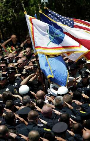 Law enforcement officers salute the colors during the procession for the graveside service for Sgt. Kenneth Gary Vann of the Bexar County Sheriff Office, at St. Joseph of Honey Creek Catholic Church in Spring Branch. Friday, June 3, 2011.   Photo Bob Owen/rowen@express-news.net Photo: BOB OWEN, Express-News / rowen@express-news.net