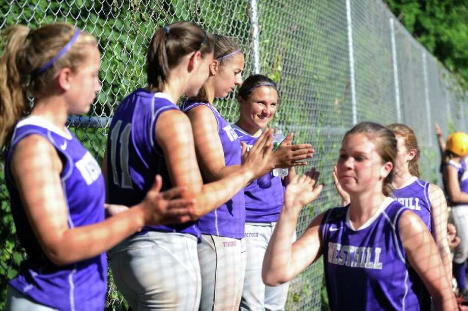 The Westhill High School softball team celebrates their win over Amity High School in the CIAC quarterfinal game at Westhill in Stamford, Conn. on Friday June 3, 2011. Photo: Kathleen O'Rourke / Stamford Advocate