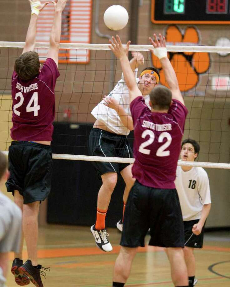 Ridgefield's Mike Peckham blasts a return against South Windsor in the Tigers' Class L state tournament quarterfinal match Friday at Ridgefield High School. Photo: Barry Horn / The News-Times Freelance