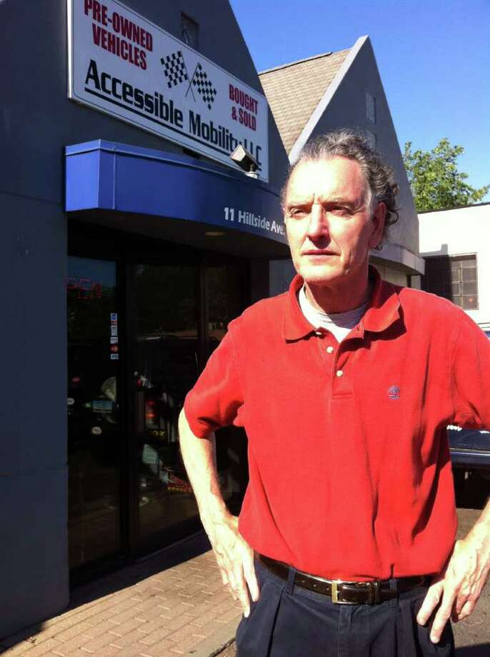 Chris Canavan, owner of Greenwich Automotive Services, stands outside his business, which is now located in Port Chester, N.Y. A former manager pleaded guilty Thursday, June 2, 2011, in connection with the embezzlement of more than $600,000 from the business between 2005 and 2008. Photo: Frank MacEachern / Greenwich Time