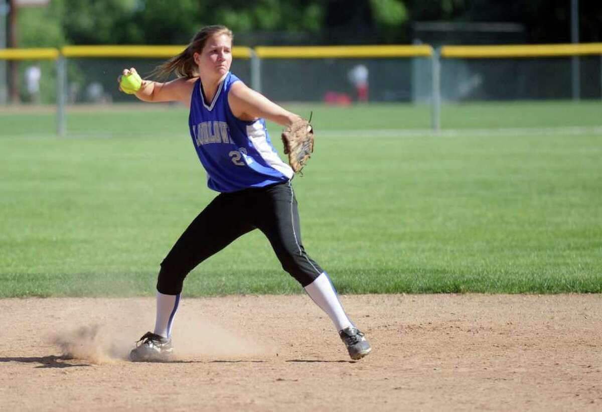 Ludlowe's Emily Nelson throws to first during Friday's Class LL softball tournament game at Fairfield Warde High School on June 3, 2011.