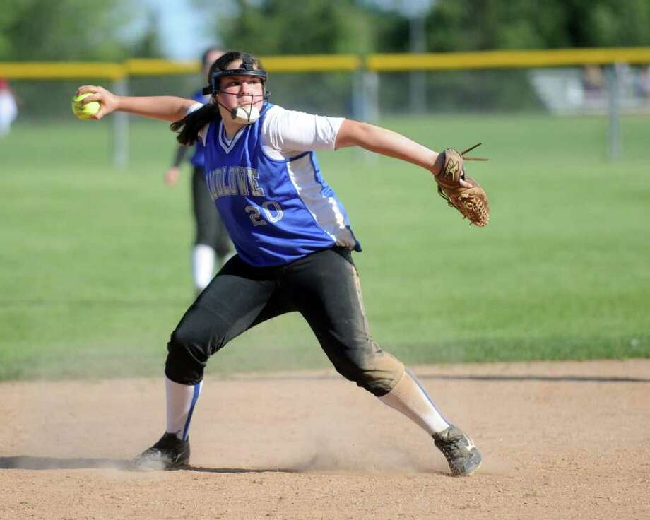 Ludlowe's Brenna Martini throws to first during Friday's Class LL softball tournament game at Fairfield Warde High School on June 3, 2011. Photo: Lindsay Niegelberg / Connecticut Post
