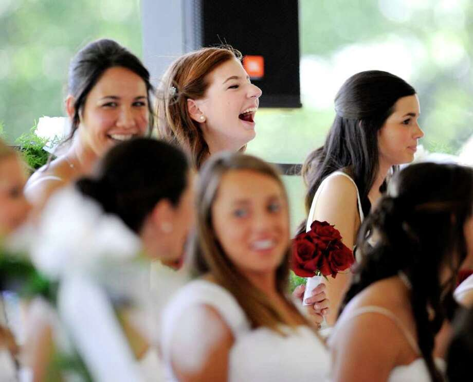 Convent of the Sacred Heart graduating senior Sarah Tranfo reacts to a speech during the Convent of the Sacred Heart Commencement, Greenwich, Friday afternoon, June 3, 2011. Photo: Bob Luckey / Greenwich Time