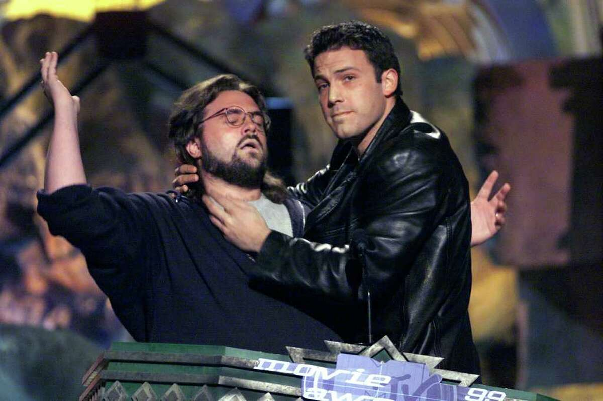 Through 19 editions, the MTV Movie Awards have offered little of historic significance but more than enough to feed the gigantic appetite of pop culture. As it returns for its 20th incarnation Sunday night (9 p.m. PT/ET, MTV, MTV2, VH1), it's worth looking back at the most outrageous moments of the past 19 -- and there have been plenty. Here in 1999, director Kevin Smith submits to Ben Affleck's chokehold. Thankfully, there's a lot more kissing than choking on the show now, as you'll see.