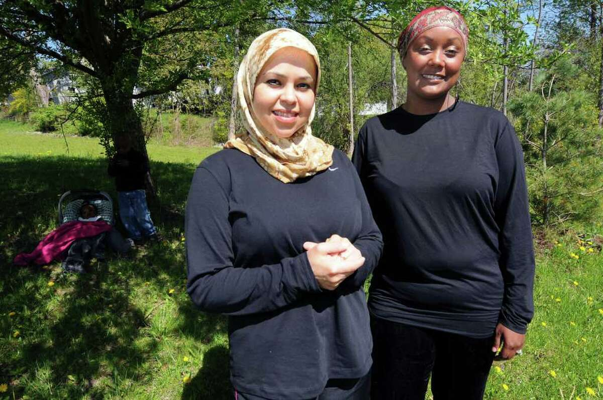 Lisa Jones of Niskayuna, left, and Anzala Alozie of Albany on Tuesday, May 10, 2011, at the Islamic Center of the Capital District in Colonie, N.Y. Both of the Muslim women are training for the Freihofer's Run. (Cindy Schultz / Times Union)
