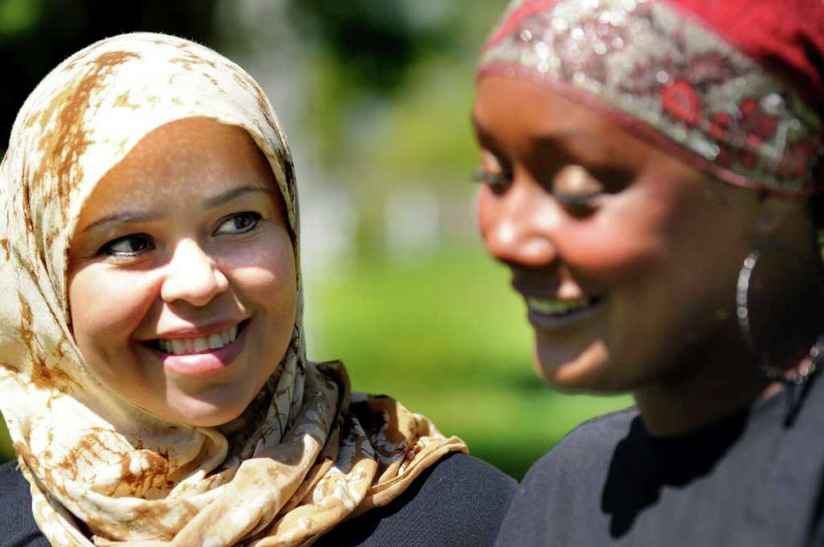 Lisa Jones of Niskayuna, left, and Anzala Alozie of Albany, right, on Tuesday, May 10, 2011, at the Islamic Center of the Capital District in Colonie, N.Y. Both of the Muslim women are training for the Freihofer's Run. (Cindy Schultz / Times Union)