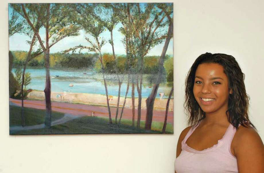 Ridgefield High School senior Morgan Hewett recently completed a series of paintings for local resident Nadya Antoniades depicting the view of Pierrepont Pond from Antoniades' home during the four seasons. Photo: John Pirro / The News-Times