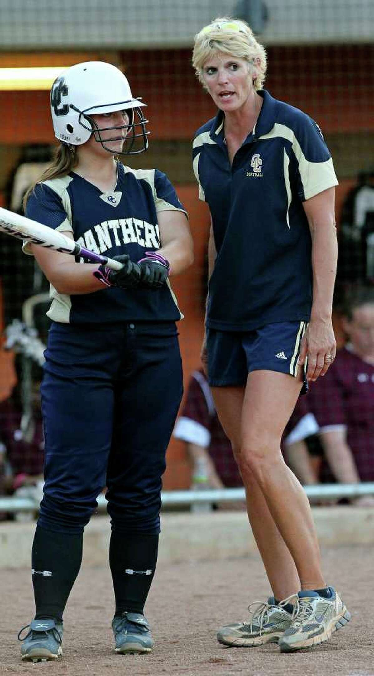 Coach Anne Lewis gives batting instructions as O'Connor plays Plano in the state softball semifinals at McCombs Field in Austin on June 3, 2011. Tom Reel/Staff