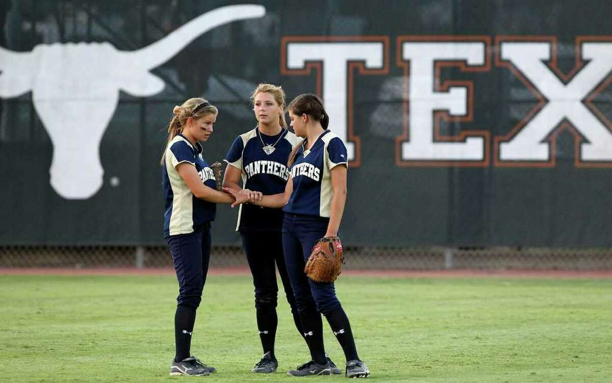 Panther outfielders group together in the last inning as O'Connor plays Plano in the state softball semifinals at McCombs Field in Austin on June 3, 2011. Tom Reel/Staff