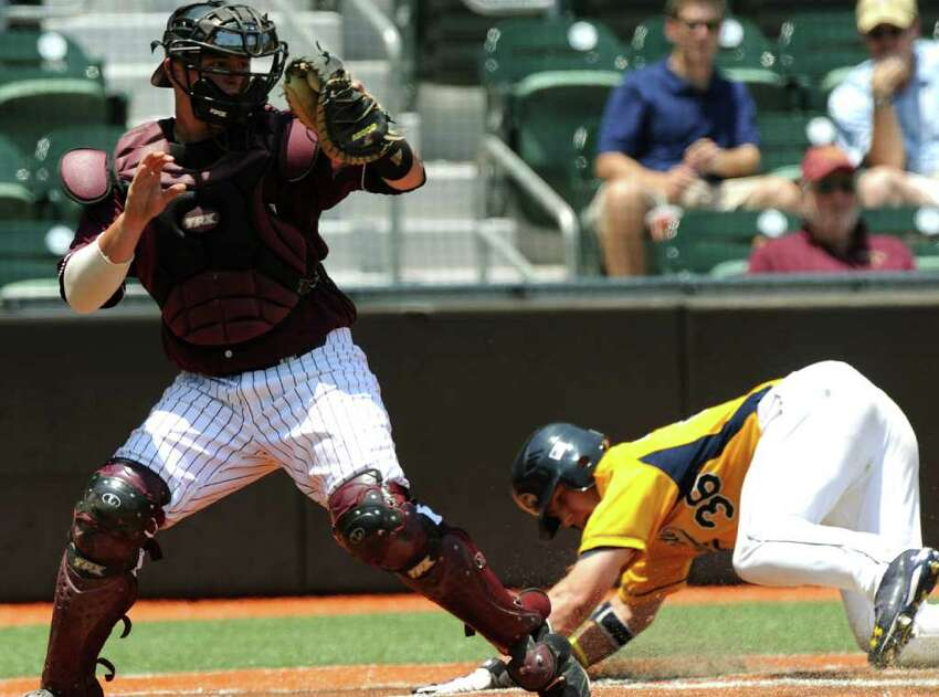 Kent State runner David Lyon slides safety into home as Texas State catcher Andrew Stumph receives the throw during the NCAA Baseball Austin Regional on Friday, June 3, 2011. BILLY CALZADA / gcalzada@express-news.net