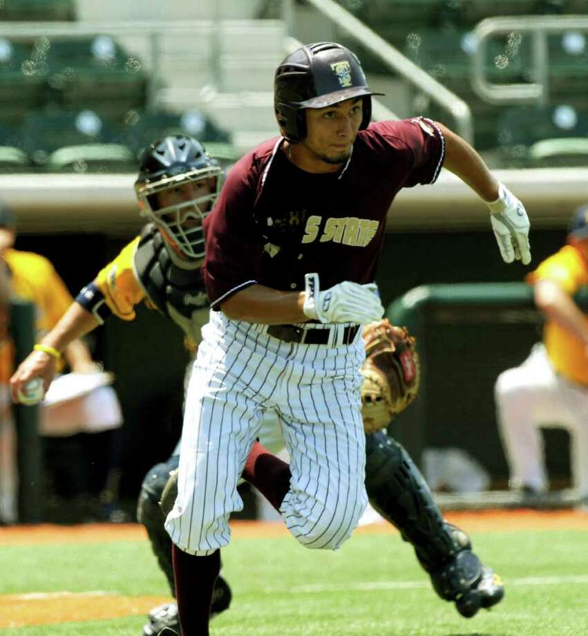 Texas State's Christian Gallegos runs for first as Kent State catcher David Lyon throws him out during the NCAA Baseball Austin Regional on Friday, June 3, 2011. BILLY CALZADA / gcalzada@express-news.net / gcalzada@express-news.net