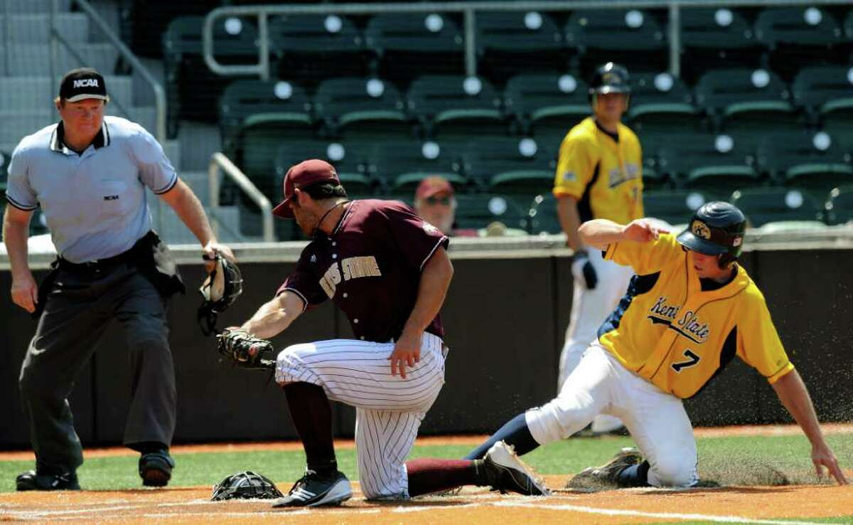 Kent State's Nick Hamilton (7) scores in the 11th inning as Texas State pitcher Jeff McVaney attempts to apply the tag during the NCAA Baseball Austin Regional on Friday, June 3, 2011. Kent State won, 4-2. BILLY CALZADA / gcalzada@express-news.net